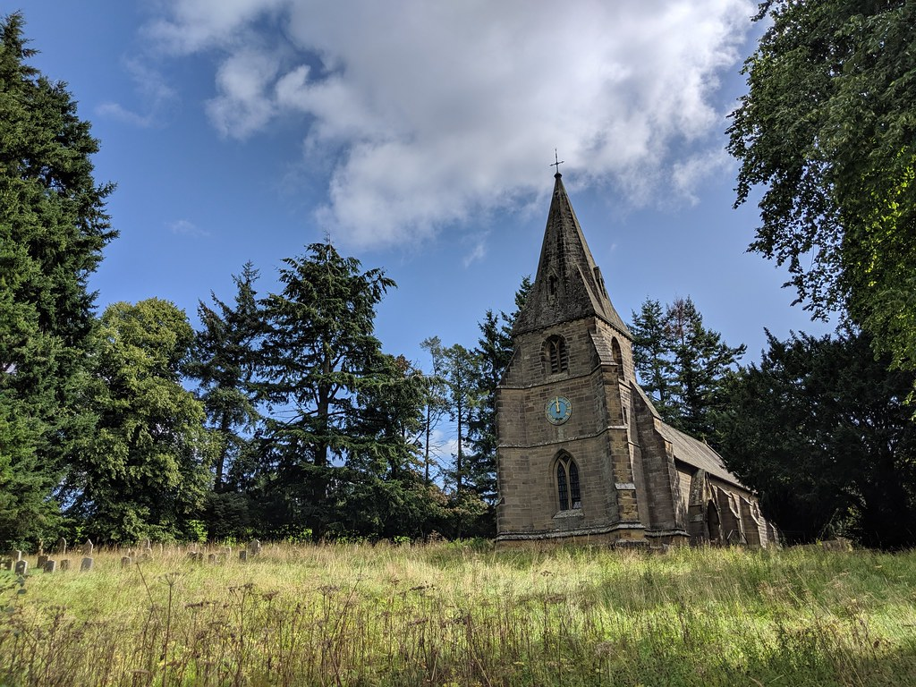 A stone church in overgrown grounds