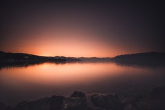 Peacefulness in Ouchy at Dawn (Maximecreative) Tags: earlymorning glow peaceful silence rocks wideangle ndgrad06 bigstopper leefilters alps mountains lakeside leman switzerland nature landscapes landscape quiet calmness calm f28 14mm samyang longexposure lowlight sunrise lake ouchy lausanne