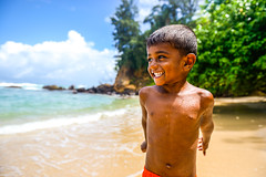 A child chilling on the beach (Roman Lunin) Tags: beach ocean travel travelling travelphotography child children kid childhood srilanka chilling