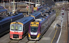 7016 and VL16 are among the many stabled railcars waiting for the afternoon peak services (bukk05) Tags: 7016 railpage:class=203 railpage:loco=7016 rpauvicsprinter rpauvicsprinter7016 sprinter vl16 vline vlinepassenger vlocity vlclass world explore export engine railway railroad railpage rp3 rail railwaystation railwaystations train tracks tamron tamron16300 trains travel yard photograph photo passenger passengertrain loco locomotive railcar 1216 railpage:class=204 railpage:loco=1216 rpauvicvlocity rpauvicvlocity1216 1116 vl55 horsepower hp flickr diesel dmu station winter 2016 australia southerncrossstation scs spencerstreetstation sss canon60d canon cumminsqsk7818 victoria vr victorianrailway victorianrailways broadgauge bg melbourne signal stable docklands bombardier goninan ptv