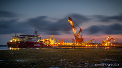 Loyang Shipyard (ronang) Tags: loyangshipyard loyang morning storm stormy ship clouds movingclouds warm lights yellow blue bluehour cranes sea seaside smoothsea