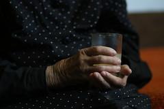 Half empty (dzepni_oktavo) Tags: old age nana granny melancholy emotive portrait loneliness sorrow gesture hands veins skin