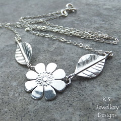 Daisy - Flower and Leaves Necklace - Sterling Silver (KSJewelleryDesigns) Tags: metalwork flower pendant necklace jewellery jewelry handmade brightsilver shine sterlingsilver silverjewellery handcrafted silver silverwire metal hammered shiny polished bright soldered soldering brushed flowers petals sawing piercing silversmith silversmithing daisy daisies blooms blossom gemstone cabochon flowerpendant swirlblossom texture stamens organic wirework stonesetting flowerandleaves