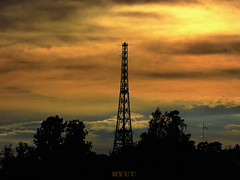 tower at sunset (Ryuu) Tags: sunset tower dark silhouettes trees sundown orange sky settingsun architecture composition silhouette blue clouds golden cloud gold light yellow sunlight dusk cloudy skyscape horizon architectural construction evening fz200 colorful