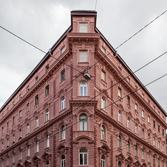 Keystoned corner block (Gary Kinsman) Tags: budapest 6thdistrict terzvros square hungary magyarorszg pest canoneos5dmarkii canon5dmkii neobaroque apartments apartmenthouse apartmentblock 2016 kirlyutca canon24105mmf4l pink corner keystoned lines cables imposing grandiose cornerblock topographics newtopographics urbanlandscape