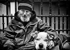 inseparable friends (White_V) Tags: street friends dog man london smile hat wall fence happy holding sitting wb 2012 whiteandblack inseparablefriends