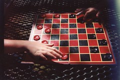(spitting venom) Tags: shadow film 35mm table hands games checkers boardgames nikonfm