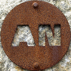 AN (chrisinplymouth) Tags: uk england sculpture art sign metal cutout circle rust iron unitedkingdom steel letters rusty plymouth plate an devon round oxidation squaredcircle rusting squircle alphabet disc corrosion mountbatten corroded doublet twoletter cw69x chrisinplymouth nauticaltelegraphcode