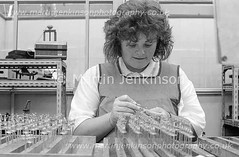 87061015.jpg (Martin Jenkinson Images) Tags: lighting blue people blackandwhite woman white black industry lamp monochrome bulb female work blackwhite track industrial unitedkingdom 1987 line 80s production worker manual collar thorn 1980s making 87 filament assembly greyscale bluecollar makers manufacture gbr manufacturing productionline thornlighting