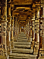 Stone Corridor (sir_watkyn) Tags: new india stone architecture century canon carved interestingness delhi ixus pillars 12th 230 complex qutub hs abigfave impressedbeauty flickrdiamond earthasia sirwatkyn
