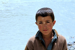 Boy on the bank of the Yarkhun River. (Syed Sarmad Bukhari) Tags: