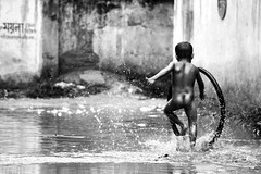 Dirt!!! Who cares?? (BACHCHA POLAPINE) Tags: white black water canon children child play action dhaka splash bangladesh bnw motijheel 55250mm 1000d