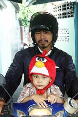 angry birds boy (the foreign photographer - ) Tags: boy hat birds portraits thailand head bangkok angry motorcycle covering khlong bangkhen thanon