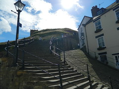 The 199 Steps (andijrae) Tags: street trip blue sea summer sky history beach church water abbey birds clouds boats town seaside nikon day waves colours village harbour vibrant seagull south yorkshire horizon north steps scenic cook july sunny australia andrew panoramic dracula historic cobble whitby captain bolton coolpix shops moors rae quaint amateur andi 199 upon barnsley rotherham teeside dearne