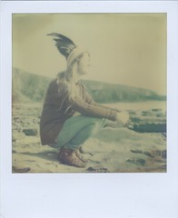 (Lizzie Staley) Tags: ocean summer film beach wales polaroid sx70 rocks view feather cliffs instant headdress artistictimezero