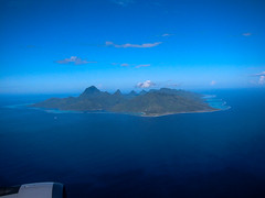 The distant view of the Tahiti Moorea Is. (sapphire_rouge) Tags: polynesia  rangiroa atool resort airport   polynsiefranaise  airplane  tahiti franchpolynesia atoll lagoon france