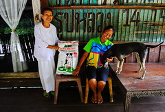 ,, Nun, No# 1 & Tinker Bell ,, (Jon in Thailand) Tags: aproiqformula nun thaismile tinkerbell dogkibble jungle nikon d300 nikkor 175528 dog k9 smile gift dogfood themonkeytemple red green yellow blue pink reflection porch women street streetphotoraphy streetphotographyjunglestyle littledoglaughedstories