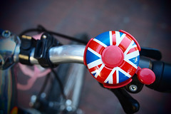 Union Jack ringer (Eric Flexyourhead) Tags: vancouver canada britishcolumbia bc gastown alexanderstreet city urban detail fragment bike bicycle handlebars bell bicyclebell british unionjack shallowdepthoffield bokeh artfilter pinhole vignette olympusep1 panasoniclumix20mmf17