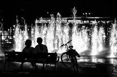 """Water magic"" (Ekaterina Toseva) Tags: water fountain night evening monochrome nature park plovdiv city couple bench love sitting lights show bike bicycle silhouette outdoors magic splash burst bulgaria 50mm nikon d7000"