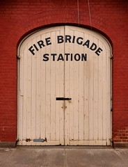 St Arnaud Fire Station (phunnyfotos) Tags: phunnyfotos australia victoria vic firestation firebrigade starnaud redbrick door doors entrance writing text sign font lettering typography countrytown nikon cfa 1883 p600 nikoncoolpixp600 padlock lock hinges arch building