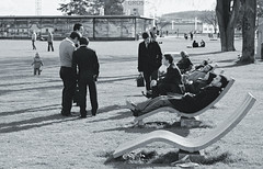 Three men arguing over a free bench