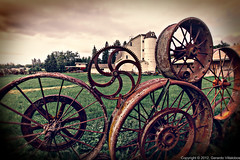 Gears and Wheels (gerardov) Tags: travel building nature ecology wheel architecture farmhouse sunrise fence landscape dawn scenery landscaping thing object scenic structures rusty objects things structure architectural rusted land environment sunrises agriculture environmentalism decayed allrightsreserved sunup daybreak ecosystem edifice oxidized edifices croplands dahmen farmscene agriculturallands farmscape agriculturalbuilding palouseregion rustcovered davidcobbworkshopjune2012