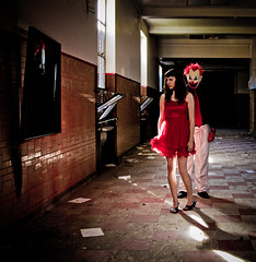 Life imitates art (Spectral Convergence) Tags: school woman abandoned scary clown detroit dirty hallway reddress grungy sneaking redford
