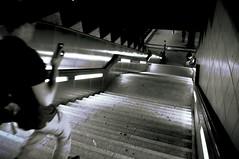 Running for the train...while on the phone! (Blue Rave) Tags: nightphotography light people blackandwhite bw building berlin lines station night stairs germany underground walking deutschland lights vanishingpoint back europa europe nightimages phone metro path transport illumination bahnhof tunnel illuminated line stairway diagonal transportation nightshots backside subwaystation sbahn publictransport pathway 2012 berlinmetro destinationunknown berlinunderground walkinginrhythm