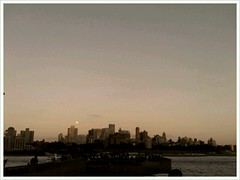 Moonrise over Brooklyn (mtchlra) Tags: cameraphone city nyc sunset newyork mobile skyline manhattan lowermanhattan 2012