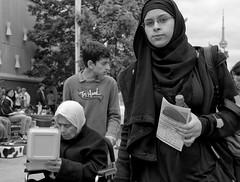 Tony Hawk - D7K 7976 ep (Eric.Parker) Tags: cne toronto canadiannationalexhibition midway fair fairground ride hijab niqab headscarf tonyhawk cntower 2011 bw monochrome blackandwhite africanamerican fairgrounds funfair