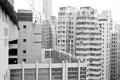 tennis (Nadia Zaboura) Tags: leica blackandwhite bw 35mm buildings hongkong summicron tennis m8 f20 leicam8