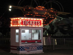 Amusements Of America Ticket Box And Tornado Ride. (dccradio) Tags: malone ny newyork franklincounty franklincountyfair communityevent fun entertainment event annual fair festival countyfair night lights amusementsofamerica biga aofa carnival midway thrillrides carnivalrides fairrides mechanicalrides amusements amusementdevice tornado wisdom wisdomrides tickets ticketbox ticketwindow