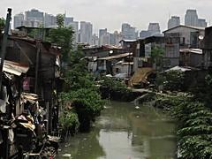 contrast (DOLCEVITALUX) Tags: slums river buildings outdoor canonpowershotsx50hs