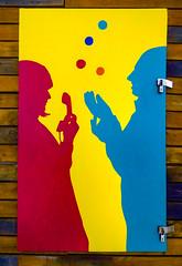 Juggling Phone Calls (Steve Taylor (Photography)) Tags: art graffiti mural streetart blue red yellow fun lady man woman newzealand nz southisland canterbury christchurch cbd city silhouette juggling juggler phone hanset balls lock latch padlock