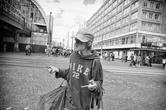 Nike 72 (Steve Lundqvist) Tags: black white bw monochrome people homeless sweater nike cap baseball berlin berlino germany poor poverty square alexander platz tramp bum hobo vagabond barbone