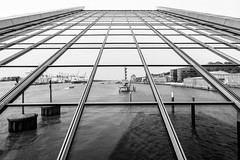 Docklands (Drummingjack) Tags: bw sw monochrome hamburg docklands hafen deutschland germany hansestadt elbe fluss river wasser water spiegel spiegelung upside down fuji fujifilm xt10 xf 16mm xf16mm f14 14 altona ships mirror maritim   mirrorless weitwinkel wideangle 24mm equivalent