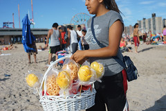 Snacks (dtanist) Tags: nyc newyork newyorkcity new york city sony a7 contax zeiss carlzeiss carl planar 45mm brooklyn coney island beach sea sand shore mangoes mango duros duritos vendor selling seller basket