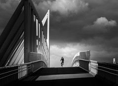 (Svein Nordrum) Tags: bw noir nero bridge bicycle dark light shadow sky clouds contrast explore explored