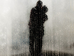 A Kiss (andy p m) Tags: london southbank affection couple coupleinfountain embrace fountain hug kissing love silhouette water waterdroplets