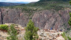 Black Canyon of the Gunnison National Park. Viewing area at the South Rim Visitor Center (lhboudreau) Tags: outdoors outdoor landscape landscapes southrim colorado usa rimdrive rimdriveroad blackcanyon gunnison blackcanyonofthegunnison westerncolorado park nationalpark blackcanyonofthegunnisonnationalpark canyon canyons stone cliff cliffs rock rocks chasm crag overlook people tree trees green greenery gunnisonpoint viewarea viewingarea mountain mountains rockformation rockformations gorge