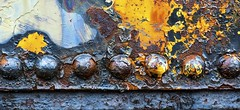 Rusty Rivets..... (Kevin Povenz) Tags: 2016 september kevinpovenz westmichigan michigan ottawa ottawacounty coopersville train rust rivet rivets rusty color colorful yellow blue orange canon7dmarkii sigma70mmmacro macro closeup round