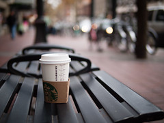 Sitting coffee (eugene.photography) Tags: blur coffee vancouver pen bench bc bokeh olympus panasonic starbucks gastown ep1 hbm m43 mft 25mmf14 microfourthirds leicadgsummilux thatsnotmycupofcoffee someonewaslazyenoughtoleaveitthereandnotthrowitinthegarbage