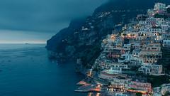 Amalfi Coast (hermez) Tags: blue italy cliff seascape fog landscape harbor europe italia campania cloudy dusk foggy calm citylights positano amalfi mediterraneansea amalfitana sorrentopeninsula canonef17404lusm canoneos5dmk2 amalfi2012 lphills