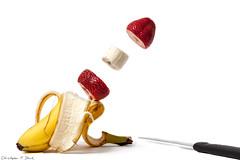 Strawberry Banana (skippys1229) Tags: shadow mystery fruit canon rebel saturated strawberry knife manipulation banana whitebackground negativespace sliced ocala odc marioncounty strawberrybanana levatation canonef24105mmf4lisusm floatingfruit marioncountyflorida ocalafl ocalaflorida rebelt1i t1i canonrebelt1i ourdailychallenge odc3 levatatingfruit