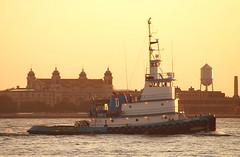 Tug Sarah Dann passing Ellis Island at sunset (Thumpr455) Tags: sunset newyork industry boat nikon marine dusk tugboat hudsonriver tug dt ellisisland d80 sarahdann sigma75300mmf4556apo
