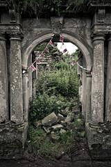 Invite (subterraneancarsickblues) Tags: house abandoned grass canon hall arch flags cumbria derelict uninhabited bunting listedbuilding kirklinton sigma18250mm eos550d rebelt2i kissx4digital
