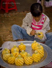 Girl cutting pineapple (NettyA) Tags: travel people girl canon lens 50mm asia market vietnam cutting southeast bacha eos550d piineapple