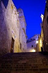 blue hour Vieste (SS) Tags: above street camera city blue light summer vacation sky italy white black church lamp colors june yellow vertical wall night stairs composition contrast buildings photography evening mood view angle pentax pov walk low perspective gimp sensual hour porta handheld bianco nero tone puglia comments vieste k5 gargano costaadriatica