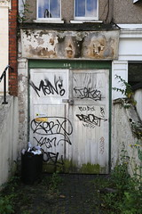 Tags (SReed99342) Tags: door uk england streetart man london graffiti tofu tags yam teko zerx drozt