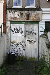Tags (SReed99342) Tags: door uk england streetart man london graffiti tofu tags yam teko zerx drozt